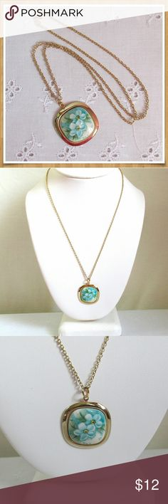 """Vintage Blue Floral Necklace 18"""" Darling blue and white floral pendant on a delicate gold tone chain. 18"""" long with a spring ring clasp. In very good condition. Pendant measures 1"""" by 1"""". Vintage Jewelry Necklaces"""