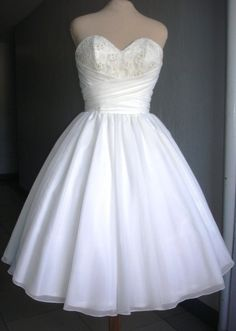 Elegant Ivory Chiffon Wedding Dress With Corset Top And Wrapped Bust Design