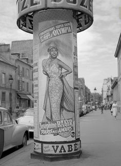 "Morris displays the poster of Josephine Baker: ""Paris mes amours"" at the Olympia (1959). © Roger-Viollet"
