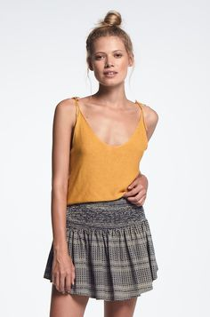 Our classic Lee Knit singlet! Ribbed at waist with thin spaghetti straps that tie at the shoulders to suit desired length. 100% Rayon One size fit...