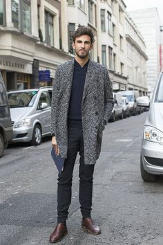 Look the best you possibly can in a dark grey tartan overcoat and black suit pants. For a more relaxed take, throw in a pair of dark brown leather chelsea boots. Shop this look for $449: http://lookastic.com/men/looks/navy-shawl-neck-sweater-charcoal-overcoat-black-dress-pants-dark-brown-chelsea-boots/6024 — Navy Shawl Neck Sweater — Charcoal Plaid Overcoat — Black Dress Pants — Dark Brown Leather Chelsea Boots