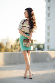 Colorful printed shirt, black waist belt with stud detail, mint bandage skirt