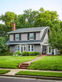 """Built in: 1910. Bought in: 2009. Size: 2,290 sq. ft. """"We bought this gem from someone who had flipped it,"""" say homeowners Holly and Kory Kunze. """"It's an old house with an updated exterior, and, combined with its location in a cute, walkable neighborhood, we were sold on the spot."""""""