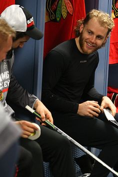 Patrick Kane smiles as he prepares his stick for morning skate on June 13, 2015. #StanleyCup