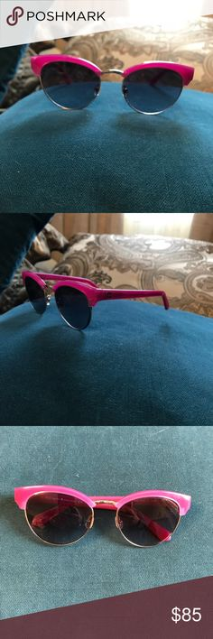 Kate Spade Wayfarer Sunglasses Kate Spade Wayfarer Sunglasses  Beautiful Hot Pink Frames accented with Gold Tone Trim and Dark Gray Lenses.  Wayfarers: classic shape for a versatile and timeless look.    In excellent condition with no observable scratches, no case with this pair. kate spade Accessories Sunglasses