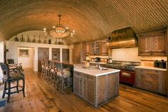 This wall was handcrafted by the designer of this kitchen using thousands of bricks imported from Mexico.