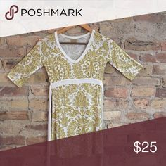 Mustard and white Athleta dress, size XXS Mustard and white Athleta dress, size XXS. Super soft and flattering pattern. I'm 5'0 and can wear as a dress but also great with leggings, jeans, layered. Athleta Tops Tunics