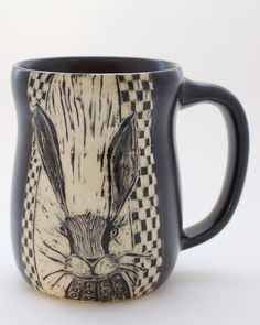 This handmade pottery mug features a rabbit etched on the front. Quite a character! The potter artist is Patricia Griffin in Cambria, Ca.