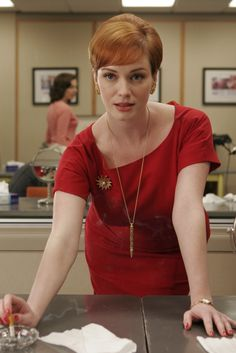 Joan (Christina Hendricks) holds a lot of power as Sterling Cooper's office manager, but alas, she's regarded as just the office manager. She loves using her sex appeal whenever she can, while dispensing advice to the other girls about the opposite sex and getting ahead. Though she's single at this time, she's carrying on a torrid affair with the married Roger Sterling.                  Source: AMC