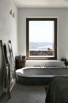This stunning Mediterranean house is located on the Greek island of Syros. Designed by (an architecture and interior design studio based in Athens, Greece) this summer house was adapted to the steep, dramatic topography and is position Bad Inspiration, Bathroom Inspiration, Interior Inspiration, Fashion Inspiration, Stone Bathtub, Concrete Bathtub, Big Bathtub, Modern Bathtub, Concrete Wood