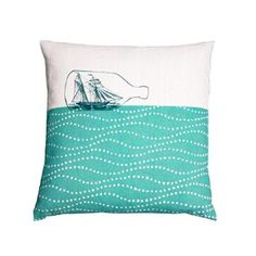 £40.00- Ship in a Bottle Cushion. This white linen cushion with a ship in a bottle print is an elegant piece of nautical home-ware. A lovely present for those who love the sea.