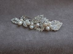 Hey, I found this really awesome Etsy listing at http://www.etsy.com/listing/159700019/rhinestone-and-pearl-bridal-hair-clip
