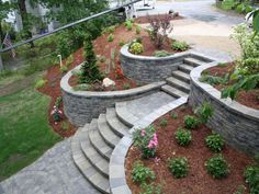 Garden, Sloping Garden Landscape Designed With Stoned Steps Walkway Between Decorative Flower Beds Retaining Walls Idea ~ Fabulous Retaining Wall Ideas #concretegarden