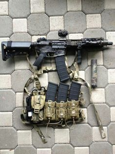 Short AR with 40 round magpul mags and suppressor