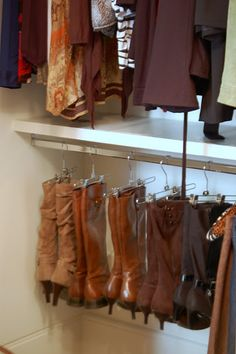 Hang boots from pant hangers to keep them straight.