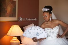 Bride Posing with Beloved Prop | Wedding Photography