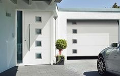 Aluminium entrance door style 173 and matching sectional garage door