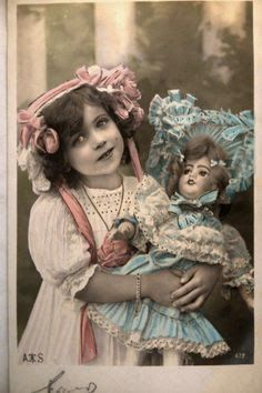 Vintage girl with a doll