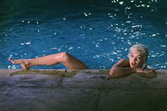 Marilyn Monroe Poolside   Photo by: Lawrence Schiller