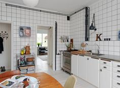 I love how it looks industrial yet cozy, and I love the pipes on the walls