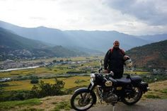 Thempu airport on background. Discovering the most pristine country on Royal Enfield.