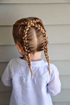 Dutch Braid - 1) Part the hair down the middle and from ear to ear into four sections. 2) French braid in the front of one section, then skip over to the section diagonal from it and continue braiding until the nape of the neck.