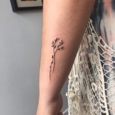 What does wildflower tattoo mean? We have wildflower tattoo ideas, designs, symbolism and we explain the meaning behind the tattoo. Simple Arm Tattoos, Subtle Tattoos, Pretty Tattoos, Beautiful Tattoos, Simple Flower Tattoo, Piercings, Piercing Tattoo, Mini Tattoos, Body Art Tattoos