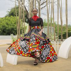 Geometric Xhosa Inspired Dress- Double layered geometric dress is made to comfortably hug your bodice and waistline while flattering your hip area with playful layers. Xhosa, Geometric Dress, Funky Design, Hug You, Bodice, Layers, African, Inspired, Skirts