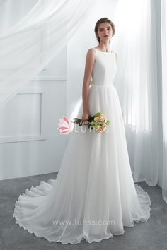 5d4c407f56e This well-designed long wedding gown features simple bateau neckline top  with illusion lace back. Lunss