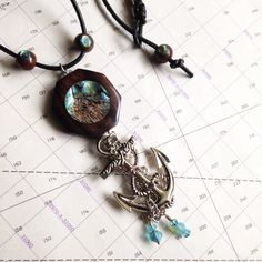 A personal favorite from my Etsy shop https://www.etsy.com/listing/234065217/abalone-nautical-big-anchor-necklace