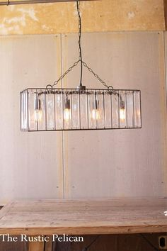 Rectangle Pendant Light with Glass Chimes Rectangle Pendant Light with Glass Chimes This bar light spans 30 inches wide and would look great over a table, counter, or bar. The style is sleek yet eclectic with it's free hanging glass chimes housed in a wi Metal Chandelier, Metal Ceiling, Modern Chandelier, Rectangle Chandelier, Chandelier Earrings, Farmhouse Style Kitchen, Modern Farmhouse Kitchens, Farmhouse Decor, Rustic Homes