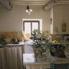 Roses and Rust: paint colors in the cabinets with the tile.
