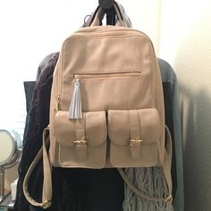 steve madden backpack beige with a light blue fringe. medium to small size and super cute. worn once but never used. perfect condition! Steve Madden Bags Backpacks
