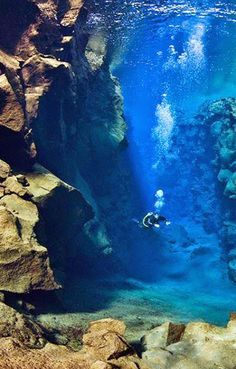 Scuba diving at the Turquoise Cave in Melissani Lake, Greece.