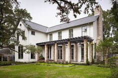 Modern Farmhouse- not a fan of the brick columns, but a different way to create a front porch effect