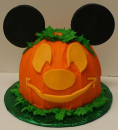 Happy Halloween Mickey Mouse! Butter cream cake with fondant Mickey ears and face.