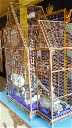 In a cramped alcove I could not get good images of this rust-color Victorian Birdcage decked out with… Retail Fixtures, Rust Color, Bird Cage, Visual Merchandising, Medieval, Victorian, Pets, Home Decor, Easy Woodworking Projects