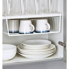 Under shelf basket to utilize vertical space, $6.99; at The Container Store