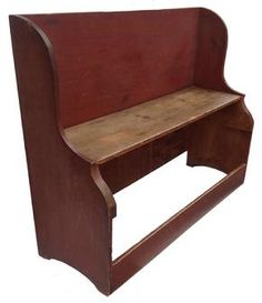 """Z423 COUNTRY BUCKET BENCH   early 19th century,the wood is  pine. with lShaped ends and  beautiful old red paint. 23""""high. seat, 42""""high. overall, 54""""long."""
