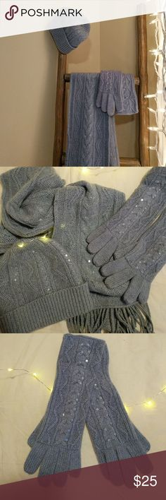 Hat, scarf, and glove set with pretty details. New Matching hat, gloves and scarf set. 100% cashmere. A pretty periwinkle blue color with some metallic yarn interlaced and some clear sequins. The gloves seem to be a slightly different color but it was purchased as a set (see pic 2). These are super soft and cozy and labeled as one size. Never worn but tags removed. Like new condition. Saks Fifth Avenue Other