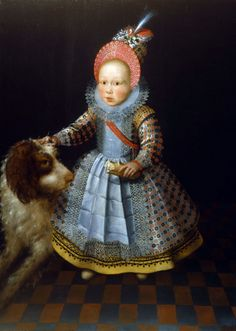 This is portrait of a young boy and his dog. It was typical for young children to be dressed in these clothes!
