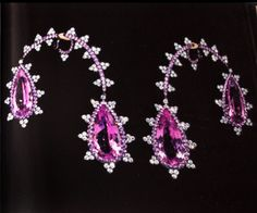 JAR from the book 'seesaw earrings in kunzite pink sapphires, diamonds platinum, silver and gold'.