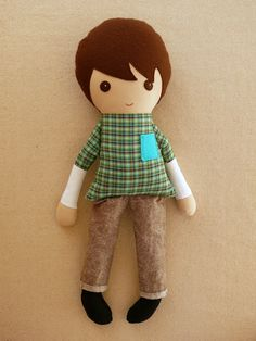 Finally! I have searched and searched for a simple doll for my son. He is 5 and has requested a soft doll like his sister's. All the dolls I found were just not quite right.    Fabric Doll Rag Doll Brown Haired Boy with Green by rovingovine, $36.00
