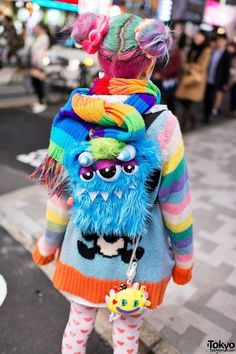Colourful lolita with candy buns hair and monster backpack