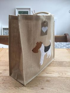 A 40cm jute bag featuring a Wire Fox Terrier design in beautiful cotton patchworking fabric; the bag has luxury padded handles and a laminated coating to the inside making it perfect for shopping. My range of shopping bags features a variety of dog breeds but if you do not see your