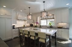 In a new kitchen lighting trend, lanterns like the Troy Lighting Maidstone add beautiful and useful light to the island.