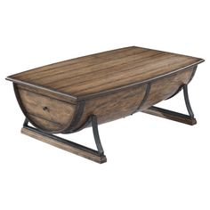 Barrel-inspired coffee table with a rustic oak finish and sled base.  Product: Coffee tableConstruction Material: