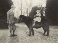 Unpublished childhood pictures of the Queen released to commemorate Prince George's birth ~  The Duke of York with Princess Elizabeth on Shetland pony, Peggy, 1930
