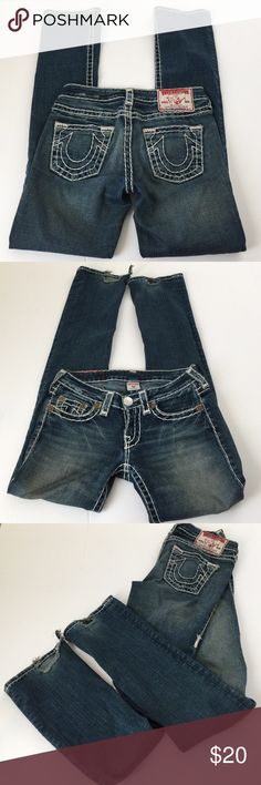 True Religion Johnny Super T Straight Jeans, 27 True Religion Johnny Super T Straight Jeans in size 27. Flat lay measure of the waist is 15.25. Rise is 7.25, inseam is 33, and leg opening is 7.5. Made from 99% cotton and 1% elastic. Features factory fading and whiskering and thick white threading. Please note bottom hems are damaged from being stepped on but in otherwise good shape. Great deal if you want to hem them. Please ask if you have any questions. True Religion Jeans Straight Leg