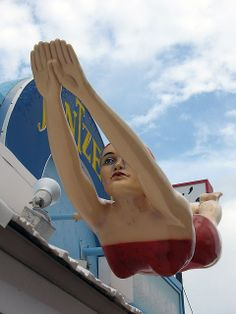 The famous Jantzen Girl is a Daytona beach landmark, diving in front of Stamie's Smart Beach Wear since 1965.